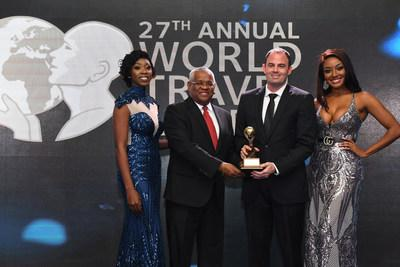 Island Routes is victorious as eight time award winner of the Caribbean's Leading Adventure Tour Operator at the World Travel Awards with David Shields (L), Vice President of Sales; and Ryan Terrier (R), Vice President of Operations.