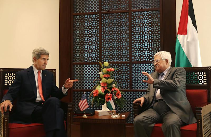U.S. Secretary of State John Kerry, left, speaks with Palestinian President Mahmoud Abbas, in the West Bank city of Bethlehem, Wednesday, Nov. 6, 2013. .S. Secretary of State John Kerry waded again into the nitty-gritty of faltering Israeli-Palestinian peace talks on Wednesday, saying he was optimistic that tensions and difficulties could be overcome, even as Israel's leader bashed the Palestinians for the poor state of negotiations. (AP Photo/Fadi Arouri, Pool)