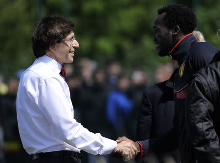 Belgium's PM Rupo shakes hands with Belgium's soccer player Lukaku during a training session at the squad's camp ahead of the World Cup, in Knokke-Heist
