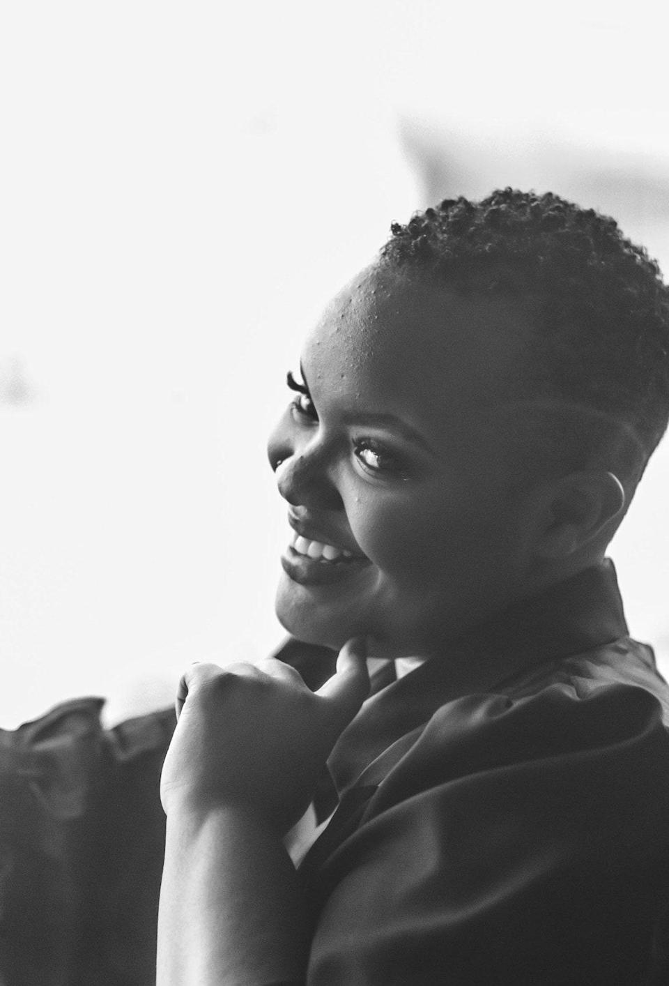 """Lily Njoroge, founder of Skin Wins. """"Textured skin, even as a licensed professional, is 100% normal,"""" she says. """"It's crucial to me to normalize all skin conditions and not view them as something that always needs correction or revision, in real life and also in images."""""""