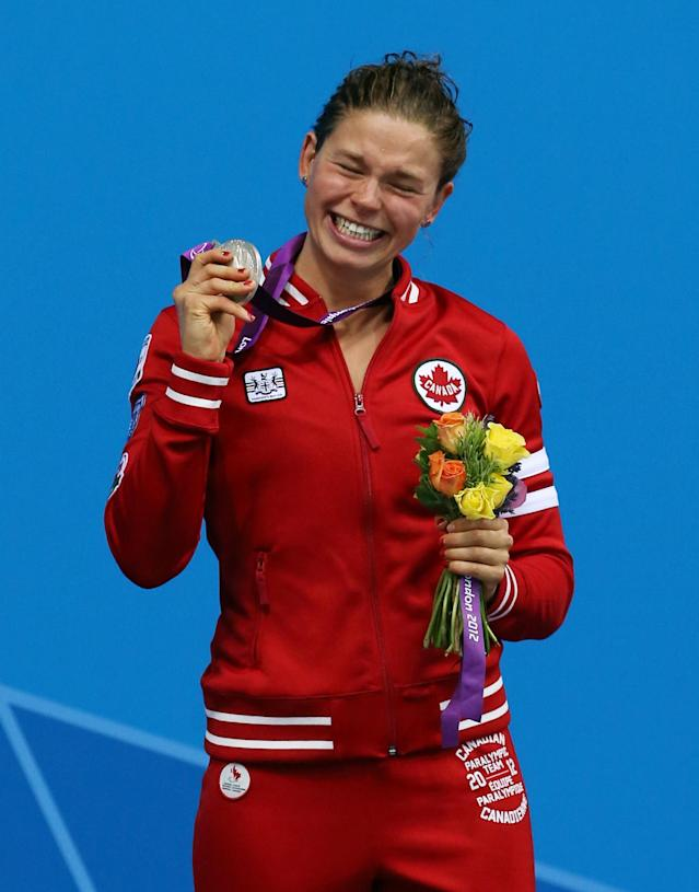 LONDON, ENGLAND - SEPTEMBER 01: Valerie Grand-Maison of Canada is presented with her silver medal that she won in the Women's 50m Freestyle on day three of the London 2012 Paralympic Games at the Aquatics Centre on September 01, 2012 in London, England. (Photo by Ian MacNicol/Getty Images)