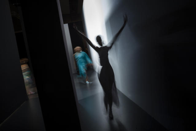 <p>In this slow shutter speed picture, a model enters the backstage area after displaying a 2017 spring/summer design by Maria Escote during Madrid's Fashion Week, Sept. 18, 2016.(Photo: Daniel Ochoa de Olza/AP) </p>