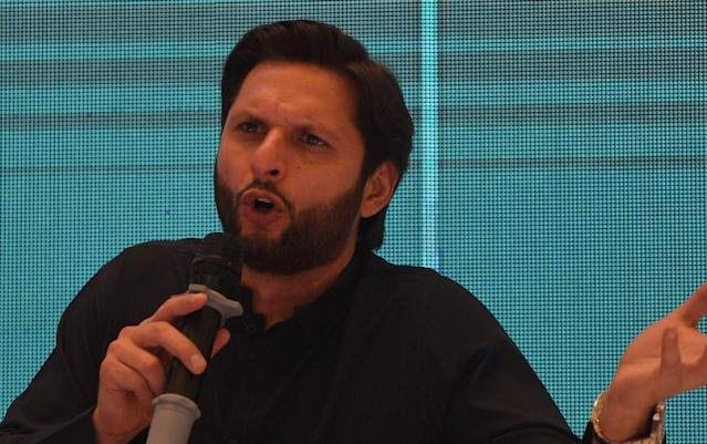 """Critics have labelled former Pakistani cricketer Shahid Afridi as a """"hypocrite"""" for refusing to let his daughters play sport (AFP Photo/RIZWAN TABASSUM)"""