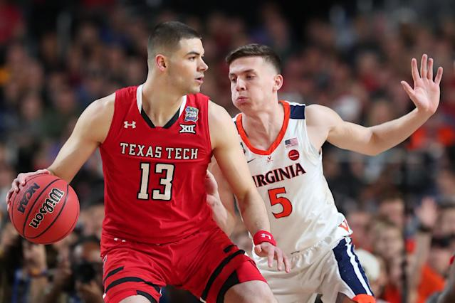 Matt Mooney #13 of the Texas Tech Red Raiders is defended by Kyle Guy #5 of the Virginia Cavaliers in the first half during the 2019 NCAA men's Final Four National Championship game at U.S. Bank Stadium on April 08, 2019 in Minneapolis, Minnesota. (Photo by Tom Pennington/Getty Images)