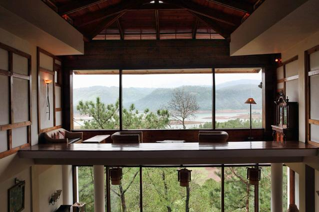 Ri Kynjai Shillong. Photo: Tom Parker - There's nothing more romantic than a monsoon break in idyllic natural surroundings—which is why Ri Kynjai is the perfect honeymoon spot. Located in the Cherrapunjee-Mawsynram district—one of the world's rainiest areas—the resort has been designed in Khasi style, with upturned boat-shaped roofs to shrug off excess water. The pine-panelled rooms have balconies overlooking the serene Umiam Lake.