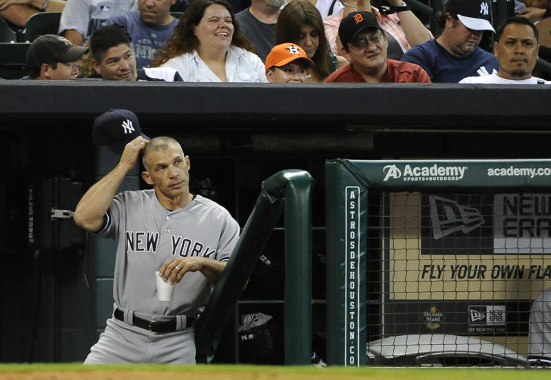 New York Yankees manager Joe Girardi scratches his head as he stands in the dugout in the 13th inning of a baseball game against the Houston Astros Sunday, Sept. 29, 2013, in Houston. The Yankees won 5-1 in 14 innings. (AP Photo/Pat Sullivan)