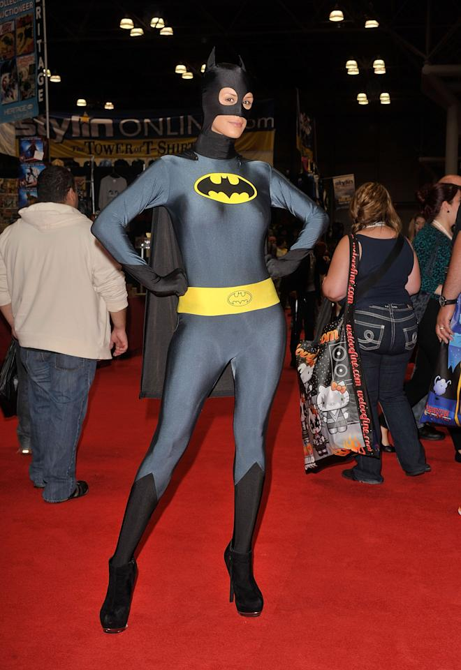 NEW YORK, NY - OCTOBER 11:  A Comic Con attendee wearing a Batman costume poses during the 2012 New York Comic Con at the Javits Center on October 11, 2012 in New York City.  (Photo by Daniel Zuchnik/Getty Images)