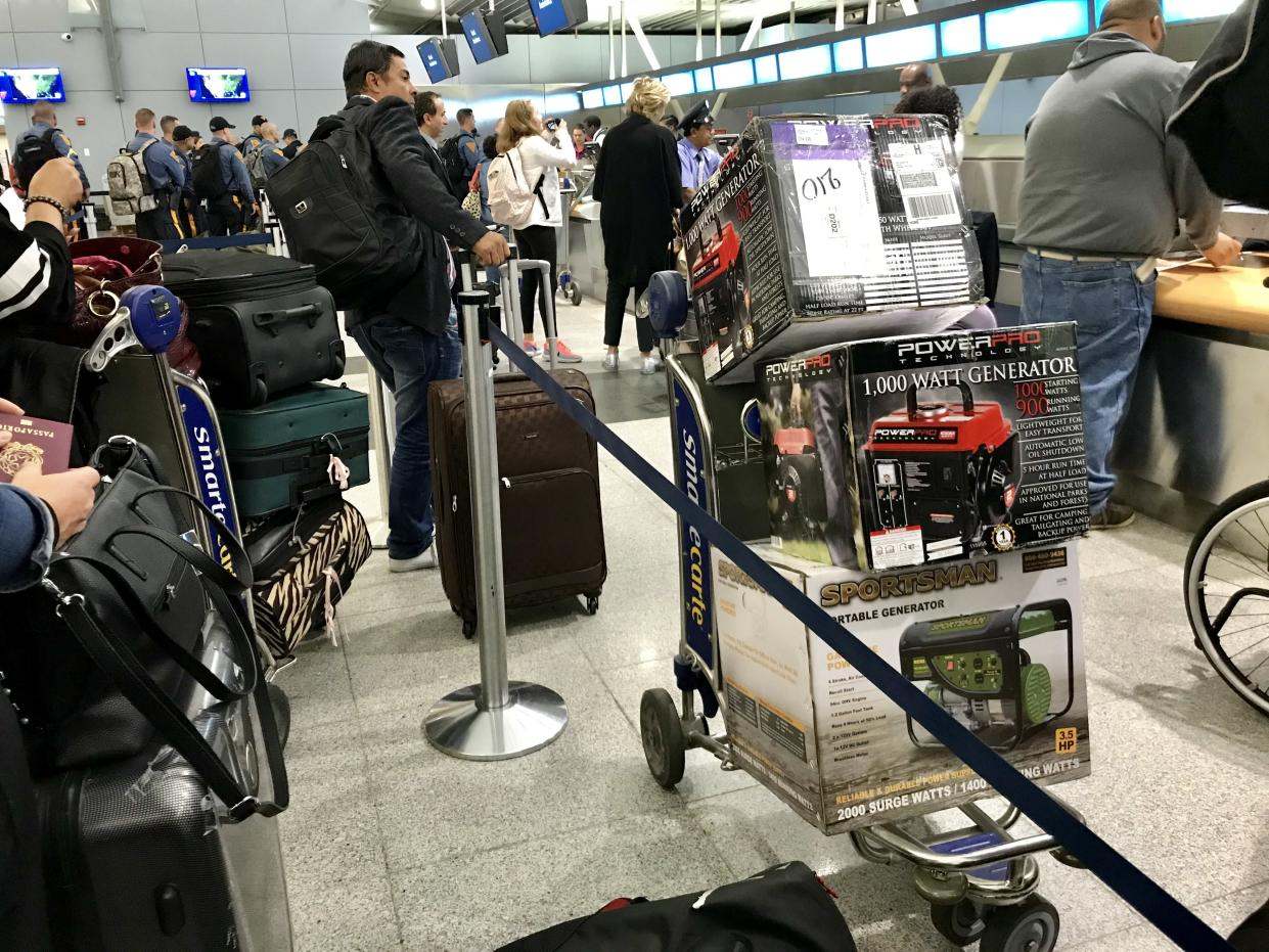 Travelers at JFK Airport in New York City prepare to check newly purchased generators as baggage for flights to San Juan, Puerto Rico. (Photo: Caitlin Dickson/Yahoo News)