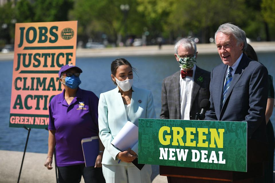 Senator Ed Markey, D-MA, and Representative Alexandria Ocasio-Cortez(D-NY) speak during a press conference to re-introduce the Green New Deal in front of the US Capitol in Washington, DC on April 20, 2021. (Photo by MANDEL NGAN / AFP) (Photo by MANDEL NGAN/AFP via Getty Images) ORG XMIT: 0 ORIG FILE ID: AFP_98D8LR.jpg