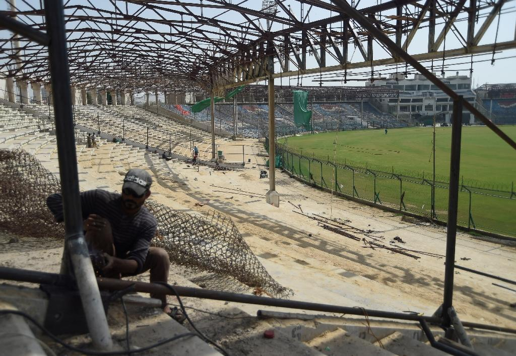 A labourer works at the National Cricket Stadium in Karachi ahead of the Pakistan Super League Final on March 25 (AFP Photo/RIZWAN TABASSUM)