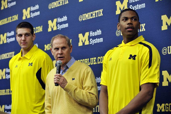 Michigan head coach John Beilein, center, speaks between forwards Mitch McGary, left, and Glenn Robinson III during an NCAA college basketball news conference, Thursday, April 18, 2013, in Ann Arbor, Mich. McGary and Robinson both announced they will forgo the NBA draft and instead return for their sophomore seasons. (AP Photo/Detroit News, John T. Greilick)  DETROIT FREE PRESS OUT; HUFFINGTON POST OUT
