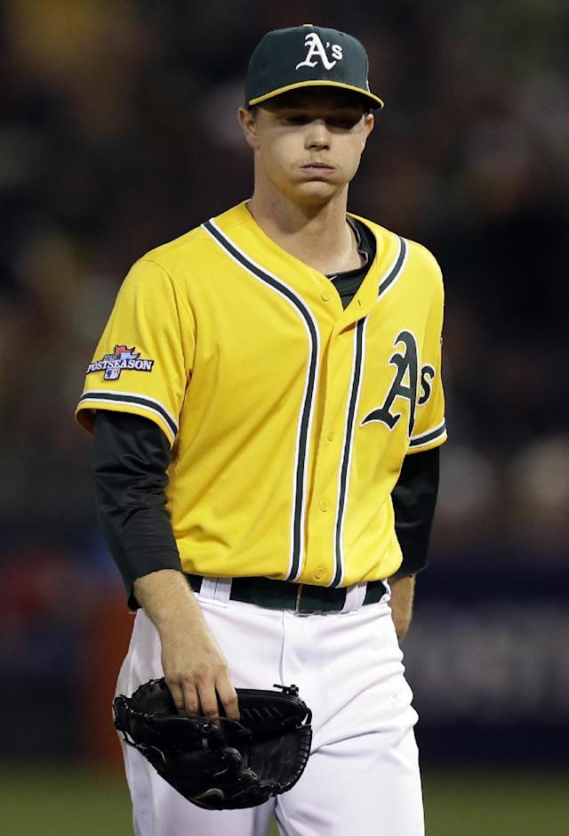 Oakland Athletics starting pitcher Sonny Gray, walks off after he was pulled from the game in the sixth inning of Game 5 of an American League baseball division series against the Detroit Tigers in Oakland, Calif., Thursday, Oct. 10, 2013. (AP Photo/Marcio Jose Sanchez)