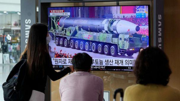 PHOTO: People watch a TV screen showing a file image of a North Korean missile in a military parade during a news program at the Seoul Railway Station in Seoul, South Korea, Monday, Aug. 30, 2021. (Ahn Young-joon/AP)