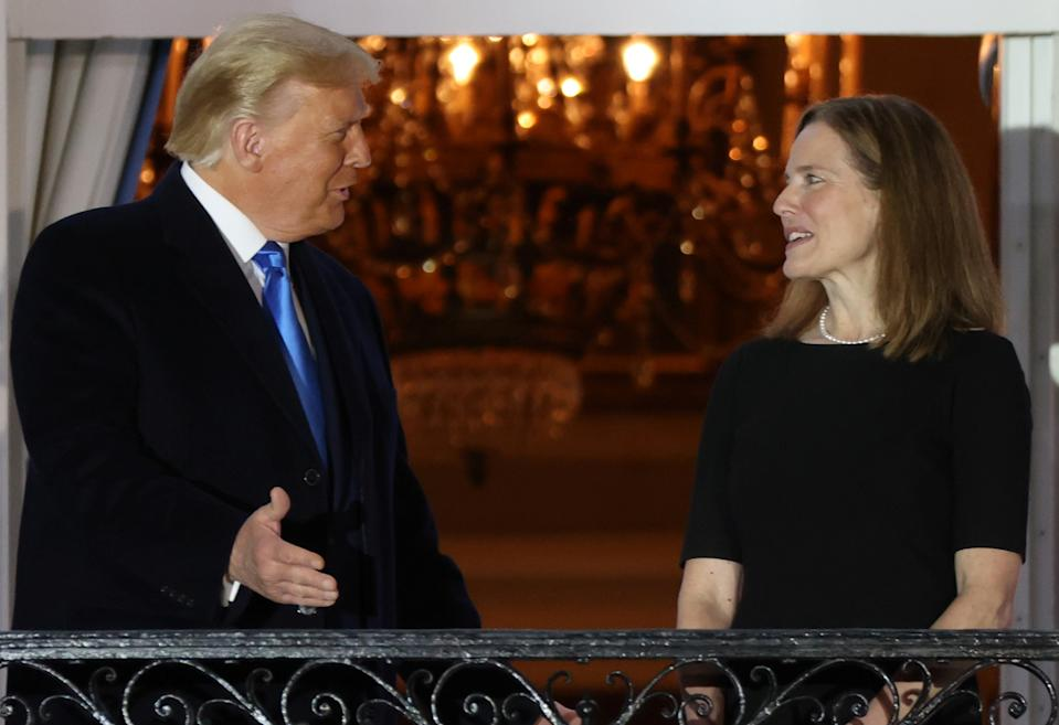 U.S. President Donald Trump speaks with Judge Amy Coney Barrett after she was sworn in as an associate justice of the U.S. Supreme Court on the South Lawn of the White House in Washington, U.S. October 26, 2020.  REUTERS/Jonathan Ernst