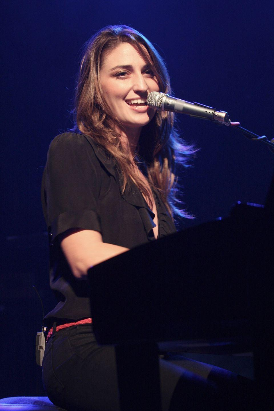 """<p>According to the singer-songwriter, plenty of people think that the story behind this song involves Sara Bareilles marching into her record label's office and telling them she wouldn't write a love song. But she later said it """"wasn't that simple."""" <br></p><p>The <a href=""""https://www.huffpost.com/entry/sara-bareilles-story-behind-love-song_n_560fdd34e4b0768127023ecd"""" data-ylk=""""slk:real story"""" class=""""link rapid-noclick-resp"""">real story</a> is that she went through some difficult co-writing sessions at the direction of her record label, but ultimately penned the now-famous song, which she says is """"a love song to my craft."""" </p>"""