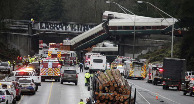 <p>A derailed train is seen on southbound Interstate 5 on Monday, Dec. 18, 2017, in DuPont, Wash. (Photo: Rachel La Corte/AP) </p>