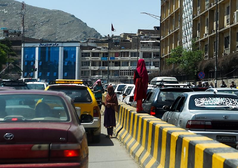 Officials and stressed-out residents say crime is surging in Kabul (AFP Photo/WAKIL KOHSAR)