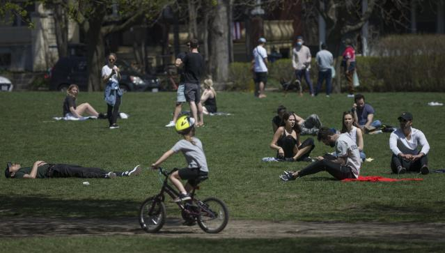 TORONTO, ON - MAY 3: Trinity Bellwoods park was a busy place today and although people were spaced out, the park had a substantial number of visitors taking in the warm weather. Scenes from around Toronto as the weather improves and people get outside to break up the monotony of being home bound during COVID-19. (Rick Madonik/Toronto Star via Getty Images)