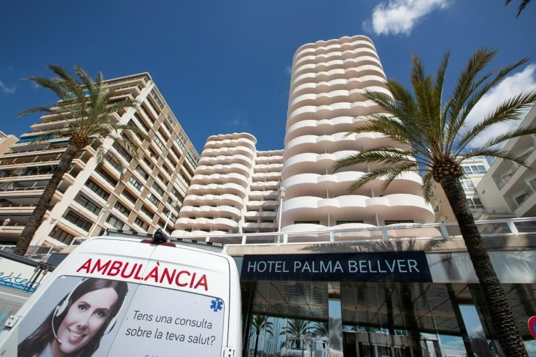 An ambulance is parked in front of a hotel where students who had contact with COVID-19 patients are quarantined in Palma de Mallorca