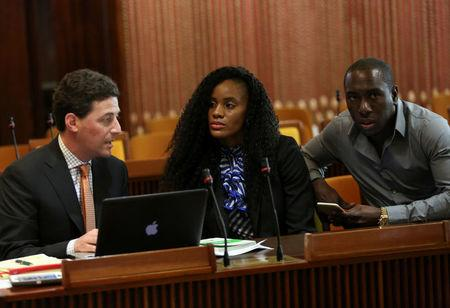 Kaliese Spencer, the reigning Commonwealth Games 400 meters hurdles champion, sits next to her attorney Paul Greene and her manager Marvin Anderson, as she attends a meeting with a panel overseeing her anti-doping case in Kingston