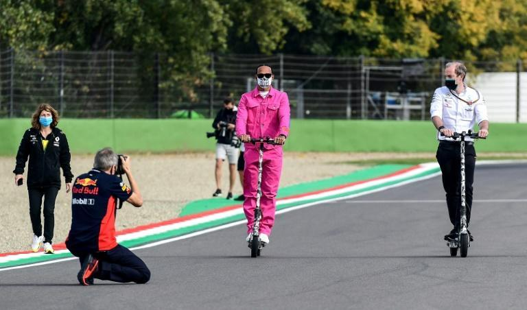 Lewis Hamilton (in pink) said inspecting the course at te Autodromo Internazionale Enzo e Dino Ferrari was an emotional experience