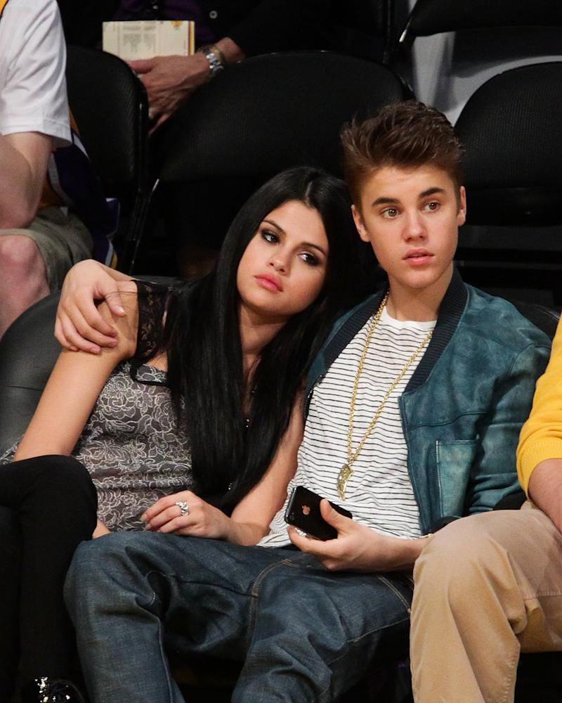 Selena Gomez and Justin Bieber at a Los Angeles Lakers game in 2012