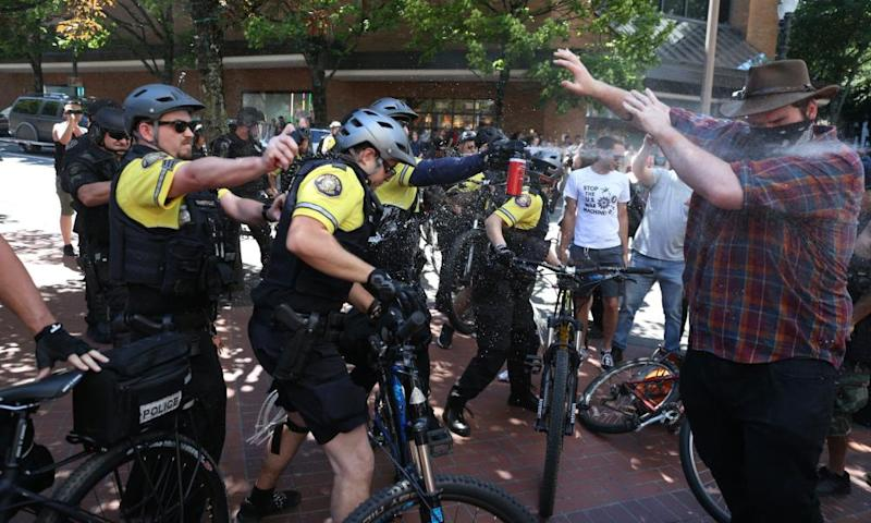 Police use pepper spray as multiple groups including Rose City Antifa and the Proud Boys in downtown Portland, Oregon.