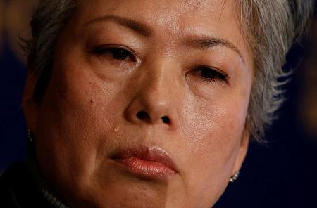 Noriko Matsumoto who fled with her children from Japan's Fukushima prefecture after the nuclear disaster, cries during a news conference in Tokyo, Japan, January 17, 2017. REUTERS/Kim Kyung-Hoon