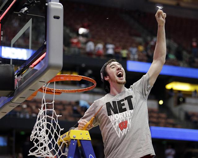 Wisconsin 's Frank Kaminsky cuts down the net after a regional final NCAA college basketball tournament game against Arizona, Saturday, March 29, 2014, in Anaheim, Calif. Wisconsin won 64-63 in overtime. (AP Photo/Jae C. Hong)