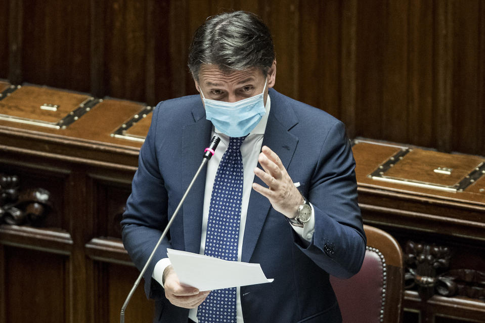 Italian Premier Giuseppe Conte addresses the Chamber of Deputies in Rome, Wednesday, Oct. 28, 2020. New nationwide restrictions aimed at limiting leisure activities to curb the spread of COVID-19 have been launched this week, they include closing restaurants and bars at 6 p.m., shutting down gyms and pools and all non-professional contact sports and closing theaters and cinemas. (Roberto Monaldo/LaPresse via AP)