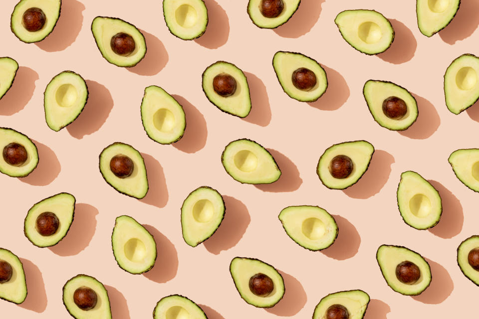 avocados against a pink backdrop