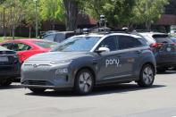 A vehicle equipped with Pony.ai's self-driving technology is parked at the company's office in Fremont