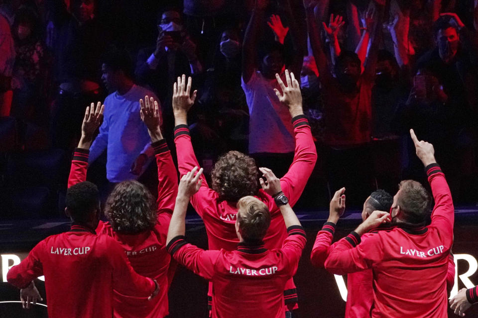 Team World players react to the crowd during a break in the match between Team World's Diego Schwartzman, of Argentina, and Team Europe's Andrey Rublev, of Russia, at Laver Cup tennis, Friday, Sept. 24, 2021, in Boston. (AP Photo/Elise Amendola)
