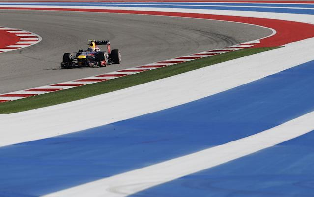 Red Bull driver Mark Webber of Australia races during the Formula One U.S. Grand Prix auto race at the Circuit of the Americas, Sunday, Nov. 17, 2013, in Austin, Texas. (AP Photo/David J. Phillip)