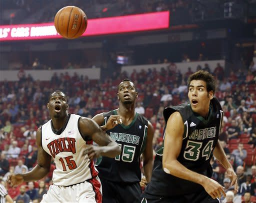 UNLV's Anthony Bennett, left, of Canada, and Hawaii's Christian Standhardinger, right, and Vander Joaquim, center, look to rebound during the first half of an NCAA college basketball game on Saturday, Dec. 1, 2012, in Las Vegas. (AP Photo/Isaac Brekken)