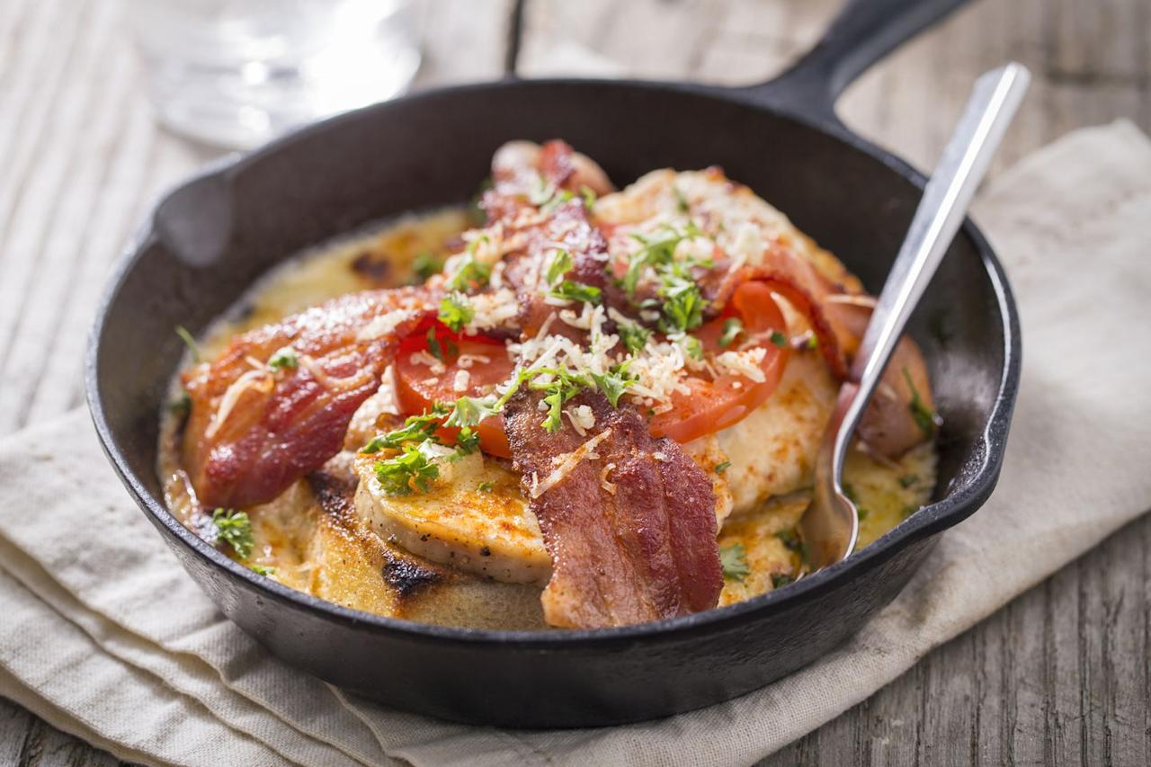 <p>First created at Louisville's famed Brown Hotel in the 1920s (some say as a hangover cure) the Hot Brown is <em>The</em> iconic sandwich of Kentucky. The openface affair features sliced roasted turkey on thick toast, smothered in a rich cheesy Mornay sauce and baked until bubbling. And in case that wasn't enough, the whole thing gets topped off with bacon and a slice of tomato. Trust us, your guests won't be able to get enough. </p>