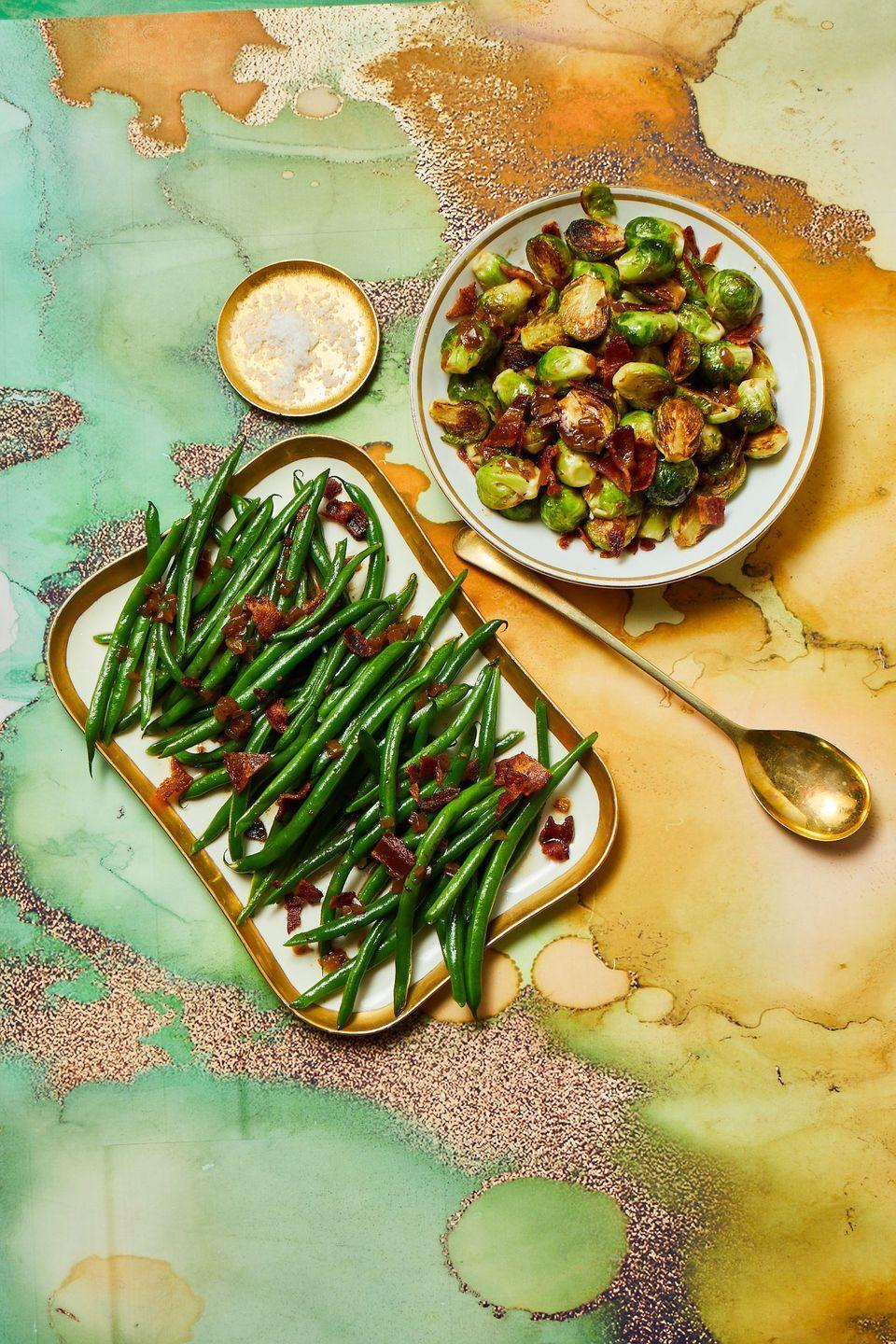 """<p>Oven space is precious during the holidays, so roast your sprouts on the stovetop instead! Tossed in a salty-tangy bacon vinaigrette, it's a side dish slam dunk.</p><p><strong><em><a href=""""https://www.womansday.com/food-recipes/a34131195/pan-roasted-brussels-sprouts-recipe/"""" rel=""""nofollow noopener"""" target=""""_blank"""" data-ylk=""""slk:Get the Pan-Roasted Brussels Sprouts recipe."""" class=""""link rapid-noclick-resp"""">Get the Pan-Roasted Brussels Sprouts recipe. </a></em></strong></p>"""