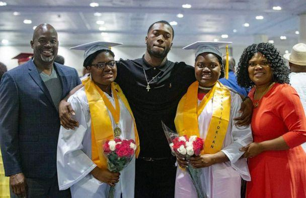 PHOTO: Tia and Tyra Smith seen on June 8, 2019, with their mother, Lemi-Ola Erinkitola, father Terry Smith Sr. and brother, Terry Smith Jr. at Lindblom Math and Science Academy's graduation in West Englewood, Ill. (Courtesy Lemi-Ola Erinkitola)