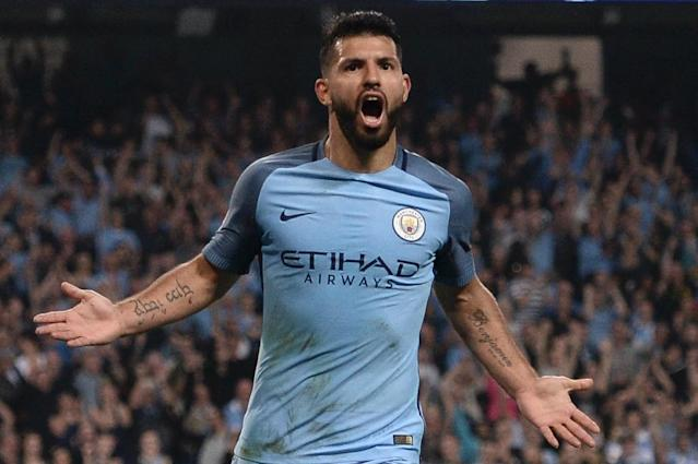 Manchester City's striker Sergio Aguero celebrates scoring their third goal and completing his hattrick during the UEFA Champions League group C football match between Manchester City and Borussia Monchengladbach (AFP Photo/Oli Scarff)