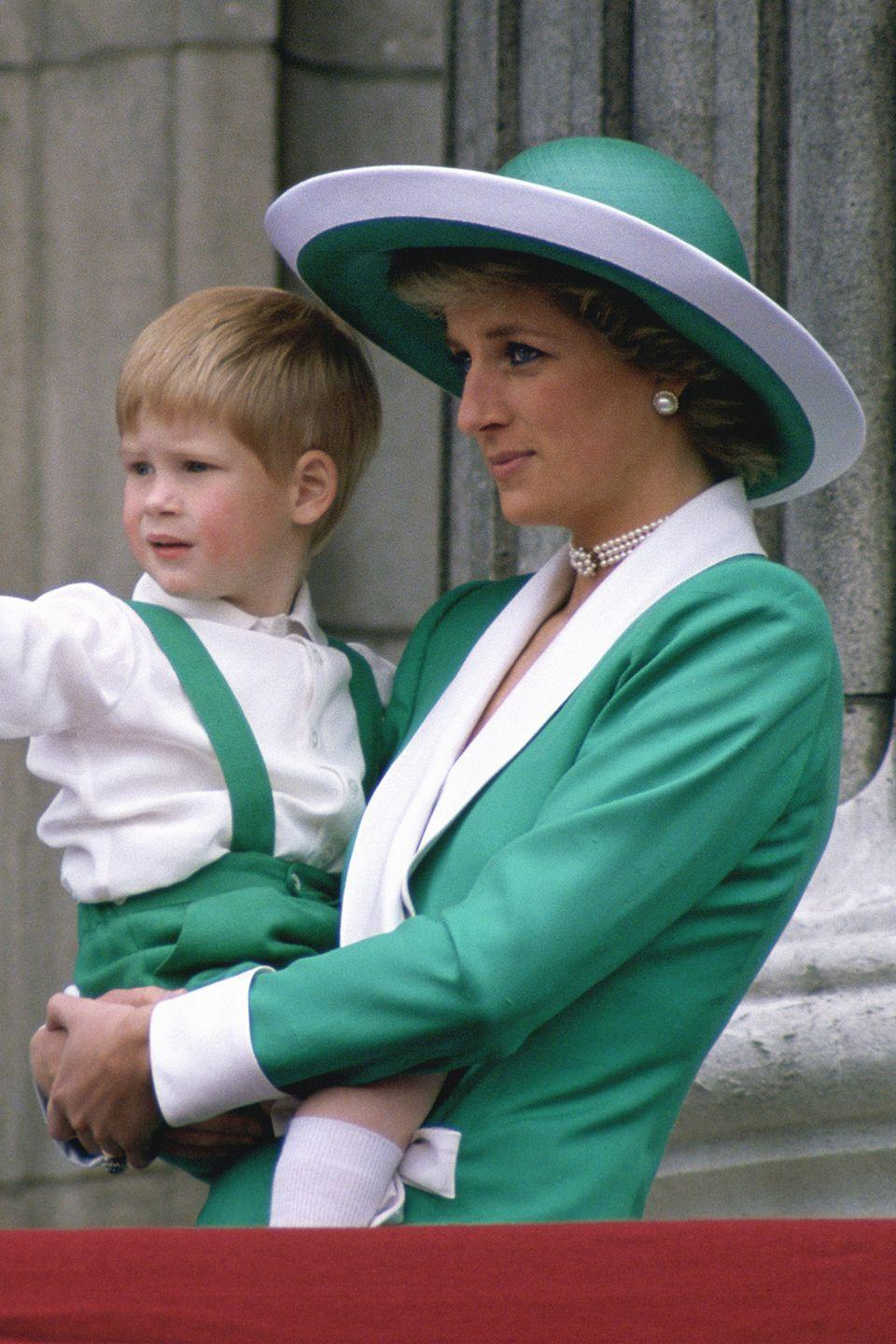 <p>In a green-and-white wide-brimmed hat while holding son Prince Harry at the Trooping of the Colour.</p>