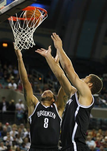 Nets hold off 76ers in OT in Brooklyn debut
