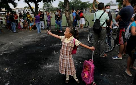 Venezuelan children, who attend school on the Colombian side of the border, have been blocked from class after the border between both countries was closed - Credit: AP Photo/Fernando Llano
