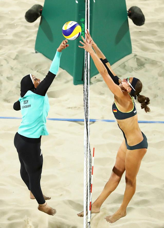 "2016 Rio Olympics - Beach Volleyball - Women's Preliminary - Beach Volleyball Arena - Rio de Janeiro, Brazil - 07/08/2016. Doaa Elghobashy (EGY) of Egypt and Kira Walkenhorst (GER) of Germany compete. REUTERS/Lucy Nicholson FOR EDITORIAL USE ONLY. NOT FOR SALE FOR MARKETING OR ADVERTISING CAMPAIGNS. TPX IMAGES OF THE DAY SEARCH ""OLY BEST"" FOR THIS STORY. SEARCH ""THE WIDER IMAGE"" FOR ALL STORIES."