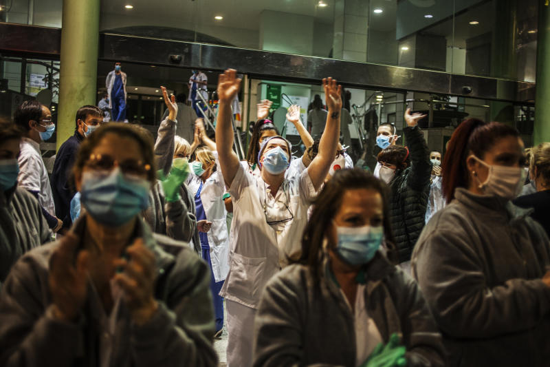 Health workers at the Hospital Clínico take to the streets and applaud the citizens who show gratitude from the streets and from their balconies and windows, during the outbreak of coronavirus disease, in Barcelona, Spain. (José Colon for Yahoo News)