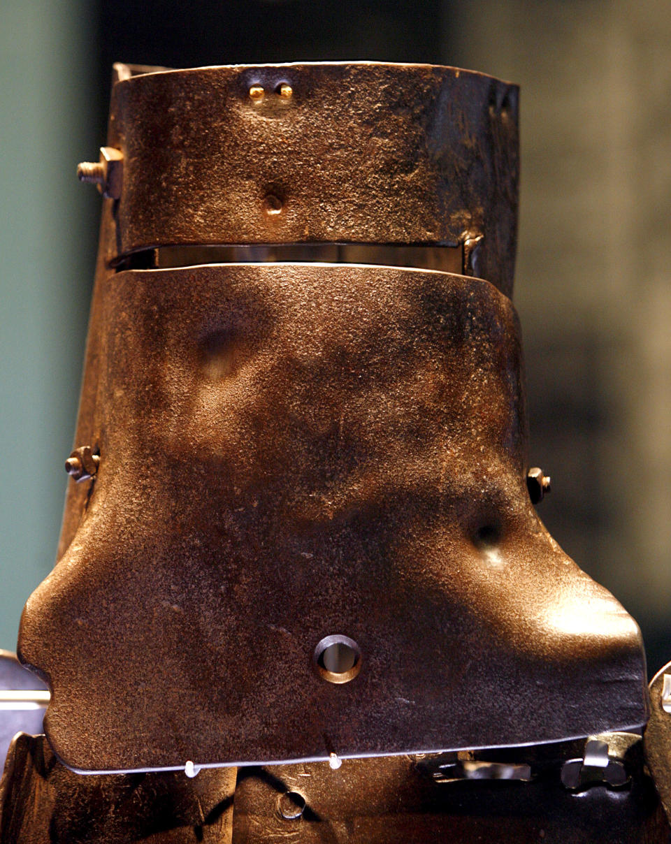 The body armour of outlaw Ned Kelly is on display at the State Library of Victoria in Melbourne, March 13, 2008. Kelly, immortalised for using home-made armour in a final shoot-out with police, became a folk hero of Australia's colonial past with his gang's daring bank robberies and escapes. Kelly was hanged at the Melbourne Gaol in 1880. Australian archaeologists believe they have found the grave of Kelly on the site of an abandoned prison. REUTERS/Mick Tsikas    (AUSTRALIA)