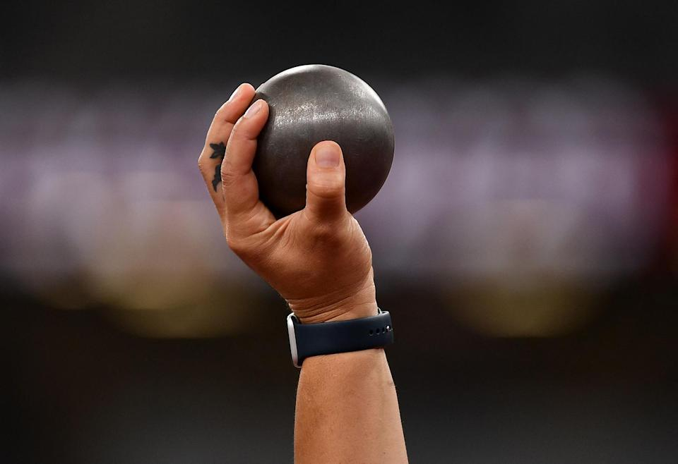 <p>New Zealand's Valerie Adams holds a shot prior to compete in the women's shot put qualification on July 30.</p>