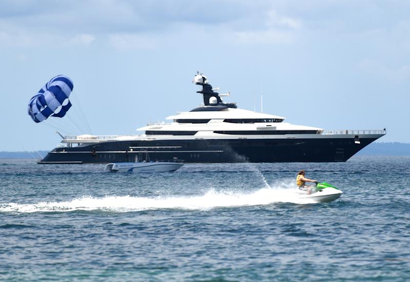 The Cayman Island-registered vessel Equanimity, which is reportedly worth some 250 million USD and is owned by Jho Low, a former unofficial adviser to the Malaysian fund 1MDB, sits in waters off Tanjung Benoa on the Indonesia's resort island of Bali on April 4, 2018. Indonesian police on February 28 boarded and searched the luxury vessel Equanimity which was being sought by US investigators as part of their probe into Malaysian state fund 1MDB. / AFP PHOTO / SONNY TUMBELAKA (Photo credit should read SONNY TUMBELAKA/AFP/Getty Images)