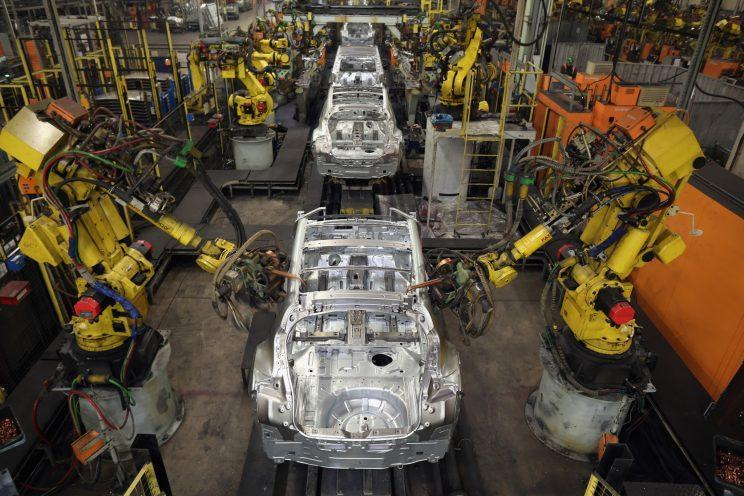 Robotic arms assemble and weld the body shell of a Nissan car on the production line at Nissan's Sunderland plant on January 24, 2013 in Sunderland, England. (Christopher Furlong/Getty Images)