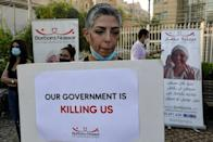 Protesters campaign against a drug shortage threatening tens of thousands of cancer patients in Lebanon (AFP/ANWAR AMRO)