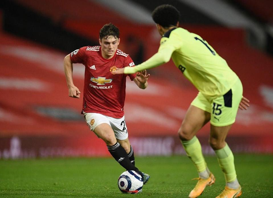 Daniel James runs with the ball whilst under pressure from Jamal LewisGetty